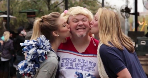 A Dallas man dresses as a cheerleader to earn $250 as part of the new video series promoting the DIS
