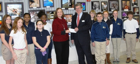 Dr. Ed Duffy, the Executive Director of the STEM Development Foundation, presents a check to Saluda Trail Middle School Principal Brenda Campbell in recognition of the school's outstanding STEM program. (Photo: Business Wire)
