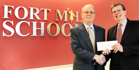 Fort Mill School District Superintendent Dr. Chuck Epps receives a check from STEM Development Foundation Executive Director Dr. Ed Duffy. (Photo: Business Wire)