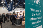 PHOTO 2: International exhibitors and attendees mingle on the expo floor before heading into prospect presentations. The 2015 NAPE Summit International expo floor showcases opportunities from 35 countries across the globe. (Photo: Business Wire)