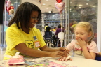 Volunteers from UnitedHealth Group brought a HeARTS-themed party to the patients and families at Children's Healthcare of Atlanta. Nichole Robeson, medical social worker, Optum Health Solutions, is pictured with a young patient at today's Project Sunshine party (Photo: courtesy of Project Sunshine).