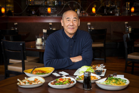 Philip Chiang displays the Chinese New Year menu at P.F. Chang's (Photo: Business Wire)