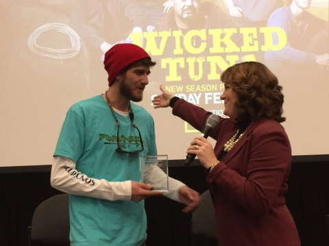 National Geographic Channel Wicked Tuna Captain Tyler McLaughlin receives the American Red Cross First Responder Award from Board Member DawnMarie Corneau at the Wicked Tuna premiere screening at the New England Boat Show in Boston, MA.