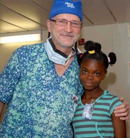 Dr. Gary and Hawa - Mercy Ships Doctor and Patient. New app increases volunteer registrations by 20%. (Photo: Business Wire)