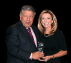 Cindy Hearn, vice president of branding and communications, CareCredit, accepts the 2014 Steven W. Kess Give Kids A Smile Corporate Volunteer Award. Pictured with Mrs. Hearn is Steven W. Kess, Vice President, Global Professional Relations, Henry Schein, Inc. (Photo: Business Wire)