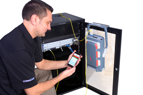 A single technician can connect directly to the base band unit at the bottom of the tower with the Optical PIM Tester. (Photo: Business Wire)