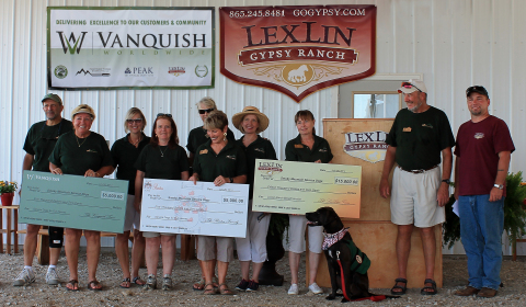 Eric W. Barton presenting 2014 donations to Smoky Mountain Service Dogs board members and volunteers on behalf of Vanquish Worldwide, LexLin Ranch & the Barton family. (Photo: Business Wire)