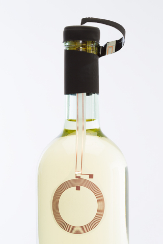 OpenSense NFC tag on a bottle of wine. (Photo: Business Wire)