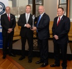 Combined Insurance President, Brad Bennett accepts Victory Media's Top Military Friendly Employer award from Sean Collins, vice president of Victory Media (publisher of G.I. Jobs magazine). L-R: Art Kandarian, retired U.S. Army Colonel and vice president of sales for military markets, Combined Insurance; Sean Collins; Brad Bennett; Joseph Pennington, retired U.S. Navy and military programs director, Combined Insurance. (Photo: Business Wire)