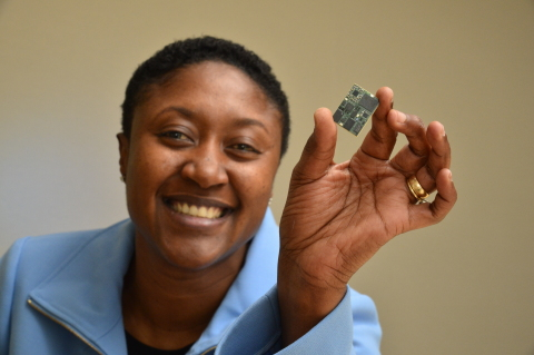 Aicha Evans, Intel's vice president and general manager of the Intel Communication and Devices Group, holds up the five-mode Intel XMM 7360 LTE Advanced solution, which supports up to Category 10 and downlink speeds of up to 450 Mbps. (Photo: Business Wire)