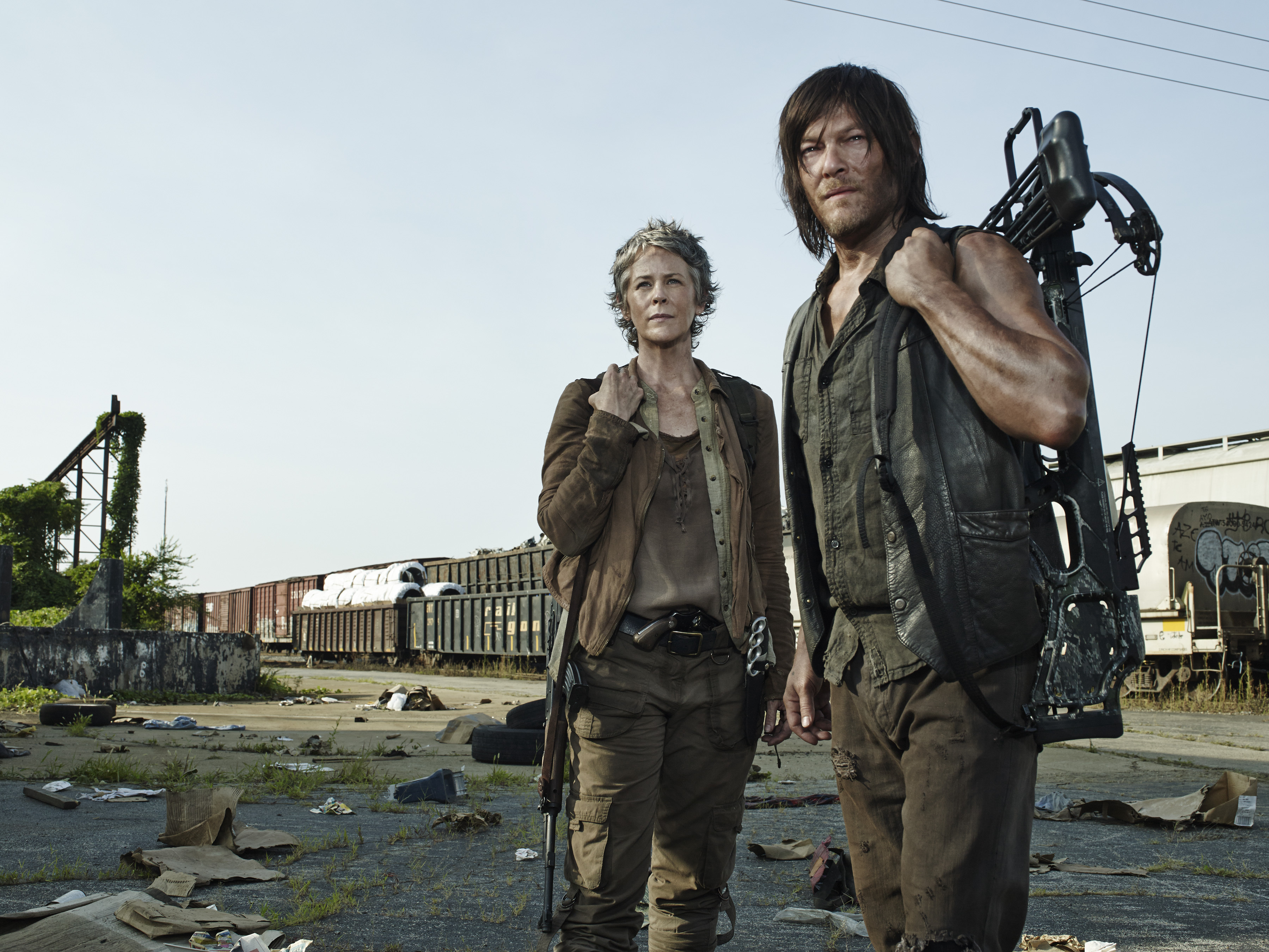 Actors Norman Reedus and Melissa McBride in The Walking Dead on AMC (Photo: Business Wire)