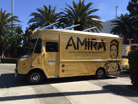 "Amira Nature Foods Ltd premieres the ""Basmati Bus"" today at Natural Products Expo West. (Photo: Business Wire)"