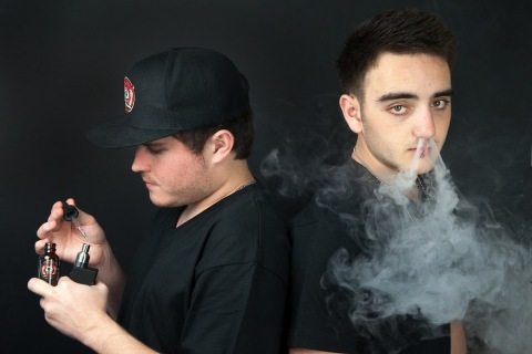 Nicholas Bull (left) and Nicholas DeNuccio, co-founders of Propaganda E-Liquid, are going full steam ahead with their uniquely crafted and flavored line of e-cigarette liquids. (Photo: Business Wire)