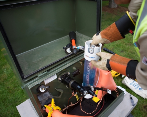 UtilX CableCURE/DMDB restoration fluid being injected into power cable. Photo: Business Wire