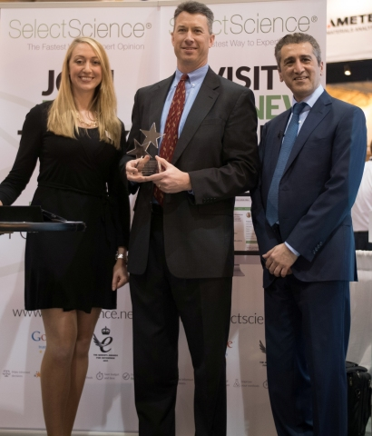 """Dan Shine (center), President of Chromatography and Mass Spectrometry for Thermo Fisher Scientific, receives the first-ever """"Company of the Year"""" award from SelectScience from the outlet's Editor-in-Chief, Kerry Parker, and CEO, Publisher and Cofounder, Arif Butt. The award was presented during the Scientists' Choice Awards ceremony on March 10, 2015, at Pittcon in New Orleans. The company's new UHPLC, the Thermo Scientific Vanquish Ultra High-Pressure Liquid Chromatography System, also won SelectScience's """"Best New Separations Product."""" (Photo: Business Wire)"""