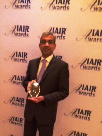 Ashok Vemuri, President & CEO, IGATE Corporation with winner's trophy at IAIR Awards - 2014 (Photo: Business Wire)