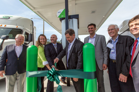 Phil Brown, Executive Director of the Greater Orlando Aviation Authority (center), Clean Energy officials and local NGV fleet operators participating in ribbon cutting ceremony at new Clean Energy natural gas fueling station at 6155 Cargo Road, Orlando, FL. (Photo: Business Wire)