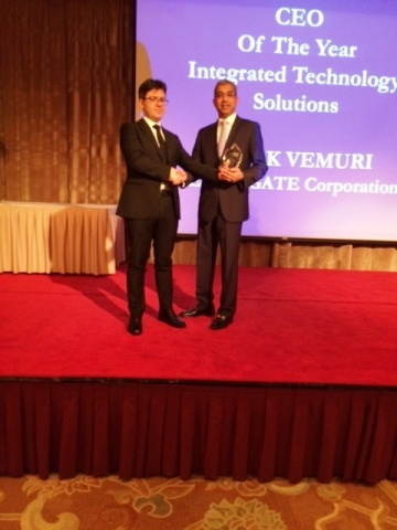 Mr. Ashok Vemuri, President and CEO, IGATE Corporation, accepting the winner's trophy at IAIR Awards ...