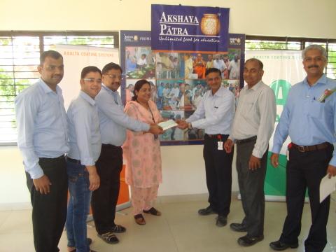 From Left to Right: Representing Akshaya Patra Mr. Dilip Soni, Mr. Anil Rawat, Mr. Tushar Dange and  ...