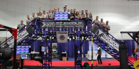 Participants climb the UTC-K2 for group photo after an early morning, 20 station Throwdown workout at IHRSA Convention (Photo: Business Wire)