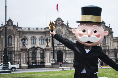 MR. MONOPOLY celebrates in front of the Government Palace of Peru in Lima. During the MONOPOLY HERE  ...