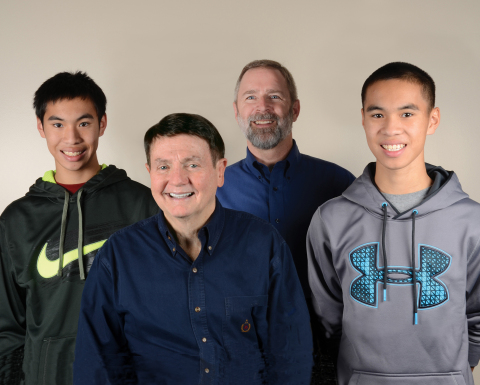 Bob Page and Dale Frederiksen, with their sons (Photo: Business Wire)