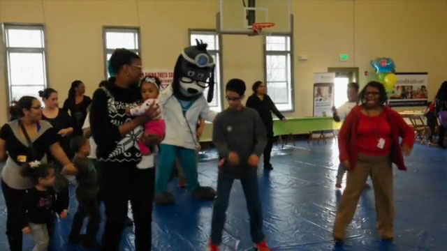 Kids, moms and moms-to-be attending the Youngstown, OH Citywide Baby Shower and Health Fair take a break to stretch their legs and join UnitedHealthcare mascot Dr. Health E. Hound in a fun, healthy dance. The Citywide Baby Shower was hosted by UnitedHealthcare and the City of Youngstown Office on Minority Health. (Video Credit: UnitedHealthcare)