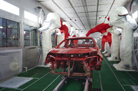 Over 300 Team Members, dressed in lint-free suits to protect the paint job, and 26 robots are respon ...