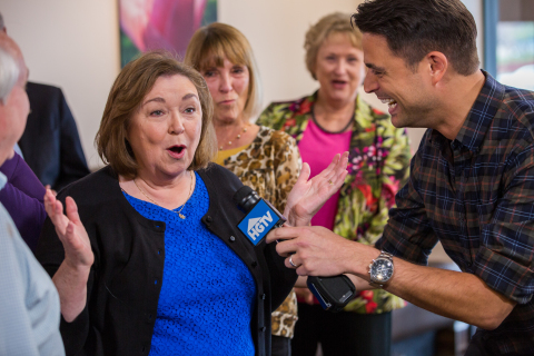 HGTV host, John Gidding, surprises Katherine O'Dell, winner of the HGTV Dream Home 2015, in Huntsville, Alabama, on Friday, March 20. The grand prize features an approximately 3,200-square-foot residence and all its furnishings on Martha's Vineyard, a new 2015 GMC Acadia Denali and a $250,000 cash prize provided by national mortgage lender Quicken Loans. (Photo: Business Wire)