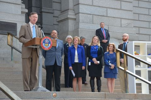 Governor John W. Hickenlooper, members of Colorado's legislature and child advocates today marked National Child Abuse Prevention Month by launching Colorado's first statewide child abuse and neglect hotline: 1-844-CO-4-KIDS. (Photo: Business Wire)