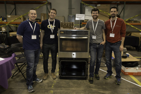 First-place winners Rob Lewis, Joshua Longenberger, Ali Faraji-Tajrishi, Nick Dillon, Rick Suel stand in front of their winning product. The winners adapted a conventional GE wall oven to roast coffee precisely using an Arduino control. Their invention, House Roast, adjusts the oven temperature automatically to mimic the professional roasting of coffee beans.
