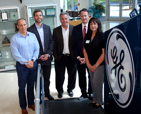 Melbourne Mayor Kathy Meehan joins GE Transportation and All Aboard leaders in touring GE's local plant where the signal equipment for All Aboard Florida's passenger-rail service will be designed and engineered. Pictured from left to right are: Keith Szewczyk, Engineering General Manager, Global Signaling; Seth Bodnar, General Manager, Global Signaling Solutions; David L. McKay, General Manager North America, Intelligent Control Systems; Adrian Share, All Aboard Florida's Executive VP of Rail Infrastructure; Kathy Meehan, Mayor of Melbourne.​ (Photo: Business Wire)