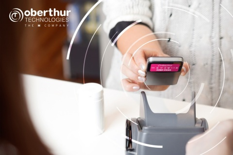 OT extends its wearables offer with a new contactless payment sticker (Photo: Business Wire)