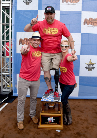 Kyle Jacobs and Kellie Pickler Celebrate with Sgt. Spanky Gibson of the USO (Photo: Business Wire)