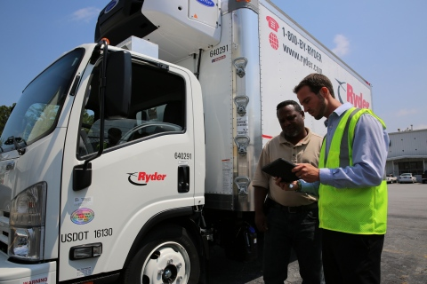 Ryder employees at the Company's rental facility in Doraville, Ga. review the Rental Signature Capture app on a tablet. (Photo: Business Wire)