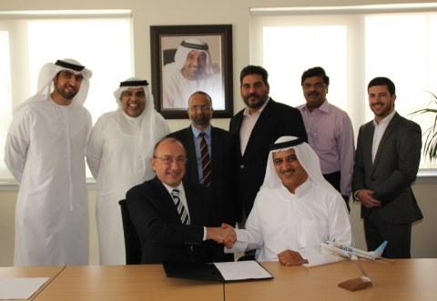 Ron Peri, Ghaith Al Ghaith and the flydubai and Radixx teams in Dubai. (Photo: Business Wire)