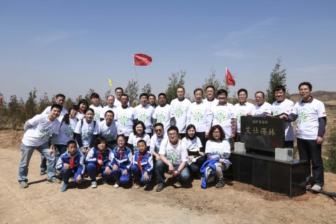 Axalta and CYDF representatives with local forestry officials in front of Axalta Forest. The plaque reads: Mother River Protection - Axalta Forest (Photo: Business Wire)