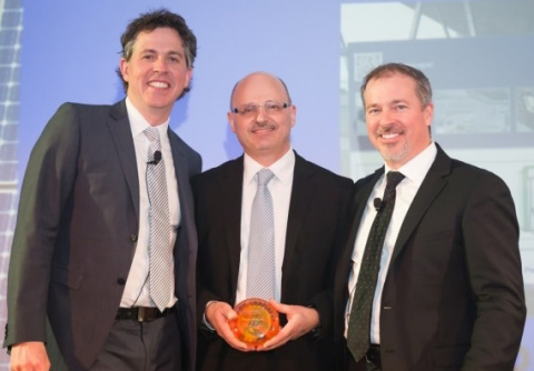 Panasonic Eco Solutions Canada Managing Director Walter Buzzelli (centre) receives Canadian Solar Industries Association Game Changer Award for Energy Management and is flanked by Gala event Co-hosts Gregory Scallen, past CanSIA Board Chair and John Gorman, President & CEO of CanSIA. (Photo: Business Wire)