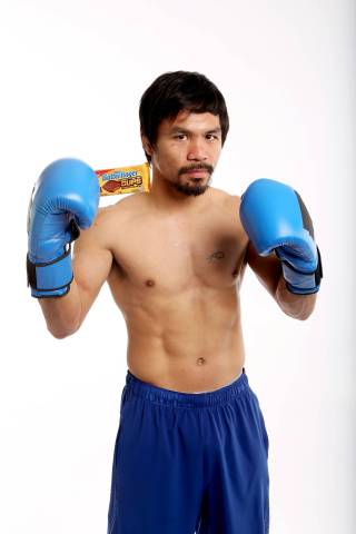 "World champion boxer Manny ""Pac Man"" Pacquiao trains for the fight of the century with Butterfinger Cups in his corner. Butterfinger is betting one million of its peanut butter cups on Pacquiao to win, as part of its ""Get In Our Corner"" countdown to the May 2nd fight. Fans can see more at Facebook.com/Butterfinger or follow the action with #GetInOurCorner at Twitter.com/Butterfinger. (Photo: Casey Rodgers/AP/Invision)"