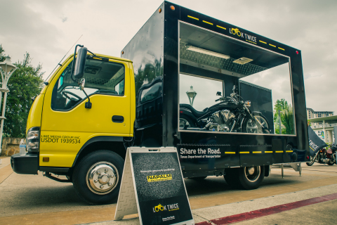 TxDOT's glass-panel truck is traveling across Texas to promote motorcycle safety awareness. People can go inside the truck and have their pictures taken on the motorcycle. (Photo: Business Wire)