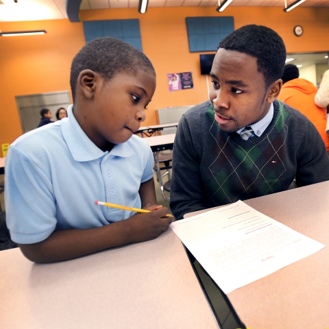 A Hayes K-8 School student receives after-school academic help from a Center for a New Generation in ...