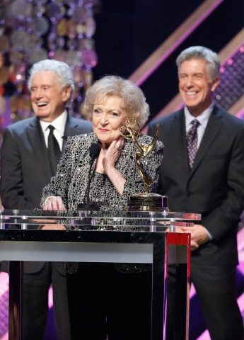 (l-r) Regis Philbin, Betty White and Tom Bergeron as Betty White accepts the Lifetime Achievement Award during The 42nd Annual Daytime Emmy Awards on Pop. Photo: Monty Brinton/CBS