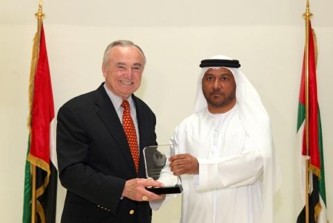 Colonel Dr. Rashid Mohammad Borshid presenting the Abu Dhabi Police Shield to New York City Police C ...