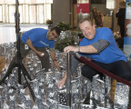 """Pritesh Patel (left) and Wayne Zaleski from UnitedHealthcare place the last of the 1,000 luminaires that lit up 185 Asylum St. in recognition of Make-A-Wish's World Wish Day. UnitedHealthcare employees raised more than $16,000 through this state-wide two-week employee """"lights of hope"""" gift campaign to help Make-A-Wish of Connecticut grant wishes to children with life-threatening medical conditions. Today marks the 35th anniversary of the founding of Make-A-Wish. The Connecticut chapter has made more than 2,500 wishes come true since its inception in 1986 (Photo: Digital Creations, Alan Grant)."""