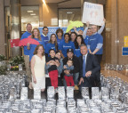 """Pam Keough, president and CEO of Make-A-Wish Connecticut (bottom left), and Jim Bedard, CFO of UnitedHealthcare's Northeast Region (bottom right), stand among the 1,000 luminaires purchased to help make wishes come true for children like Louis (first row, second from left) and his family. UnitedHealthcare employees raised more than $16,000 through this statewide two-week employee """"lights of hope"""" campaign to help Make-A-Wish Connecticut grant wishes to children with life-threatening medical conditions. Today marks the 35th anniversary of the founding of Make-A-Wish. The Connecticut chapter has made more than 2,500 wishes come true since its inception in 1986 (Photo: Digital Creations, Alan Grant)."""