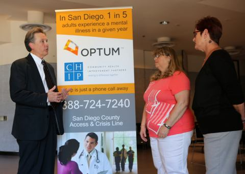 Michael Bailey, M.D., medical director of Optum San Diego (left), discusses issues surrounding mental health and suicide prevention with instructors from Optum who are leading free suicide prevention and mental health training courses in San Diego during Mental Health Awareness Month. In San Diego, one in five adults experience a mental illness in a given year, and one in four young adults ages 18-24 has a diagnosable mental illness. L to R: Bailey; Pamela Binkley, MS, CPRS, Optum; and Dona Dmitrovic, MHS, Optum (Photo: Jamie Scott Lytle).