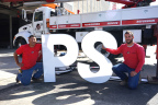 Workers take a break from installing a giant sign on the side of Public Storage 5500 San Fernando Rd in Glendale, Calif., opening May 6. (Photo: Business Wire)