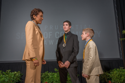 """Good Morning America"" co-anchor Robin Roberts congratulates Hunter Gandee, 15, of Temperance (center) and Caleb White, 12, of Commerce Township (right) on being named Michigan's top two youth volunteers for 2015 by The Prudential Spirit of Community Awards. Hunter and Caleb were honored at a ceremony on Sunday, May 3 at the Smithsonian's National Museum of Natural History, where they each received a $1,000 award. (Photo: Zach Harrison Photography)"