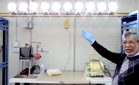 Dr. Mohammad Enayetullah, a pioneer in fuel cell technology, demonstrates Trenergi's one kilowatt fuel cell for a group of investors. (Photo: Business Wire)