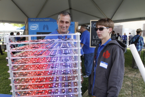 Intel CEO Brian Krzanich, left, is showing an interactive LED Matrix by Joey Hudy, 17, right, at the Intel booth during last year's Bay Area Maker Faire in San Mateo, Calif., Saturday, May 17, 2014. Ten Intel(R) Galileo development boards are used to power this matrix of 1,000 LEDs. Hudy was Intel's youngest intern. (Photo: Business Wire)
